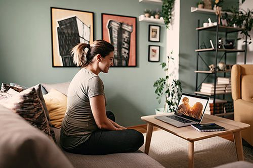 A birth mother video chats with her daughter and the adoptive mother