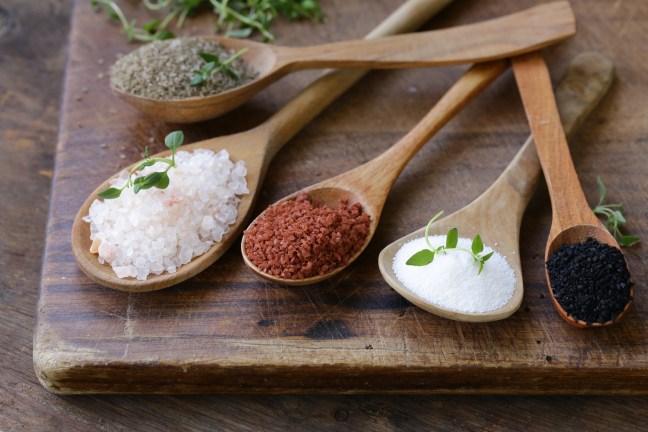 different varieties of salt in wooden spoons