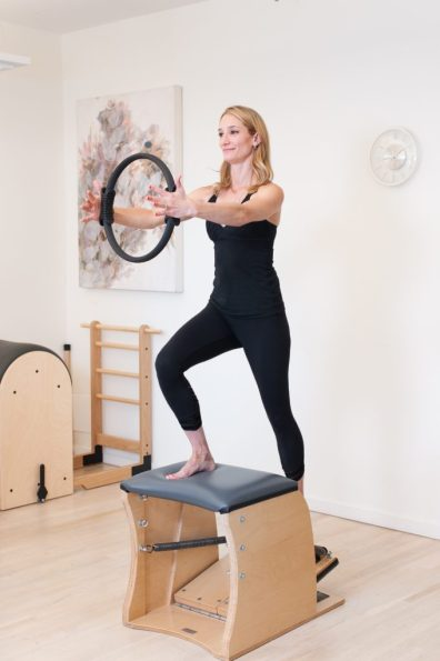 Alma Ramos, Kinesis Co-Owner and Pilates Instructor, demonstrates the Wunda Chair apparatus.