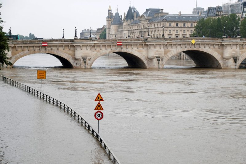 Road signs appear isolated in the rising waters from the Seine River as high waters causes flooding along the Seine River in Paris