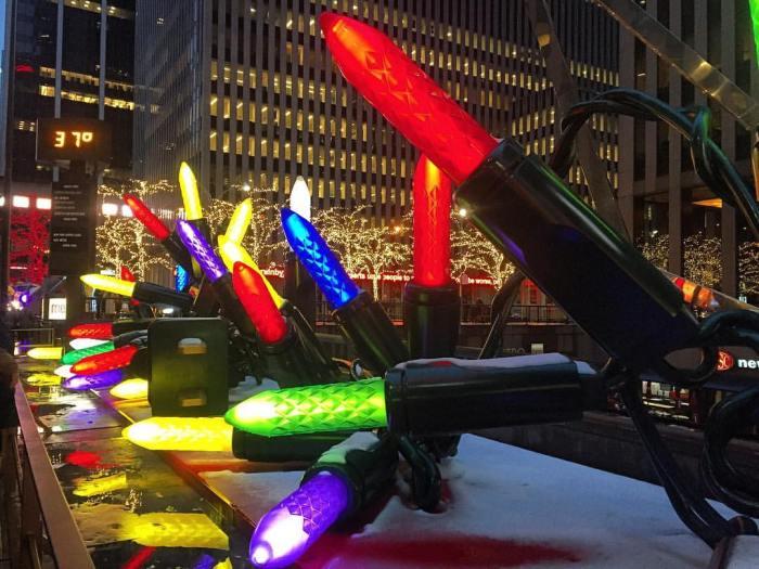giant christmas lights and holiday decorations outside radio city music hall
