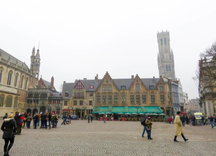 main town square of bruges on a foggy day