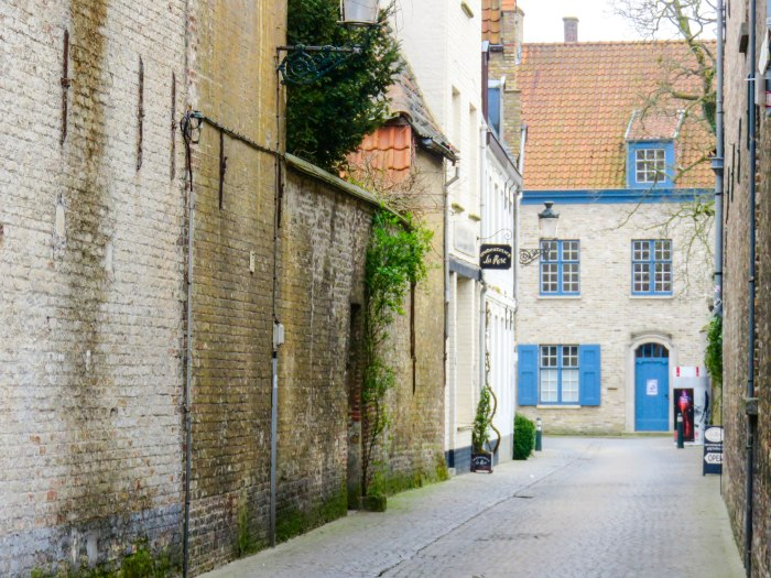 a quiet, deserted side street in bruges