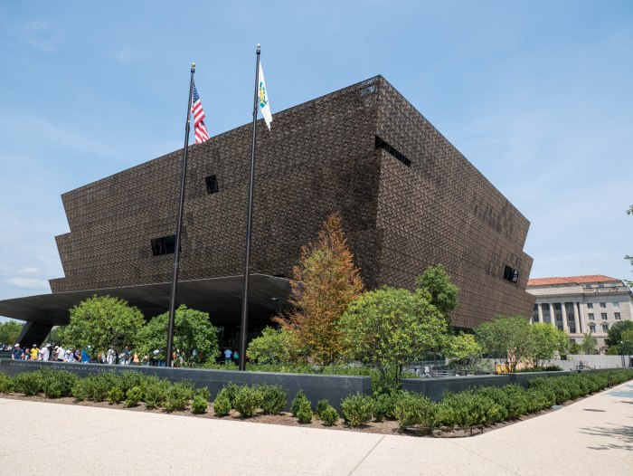 exterior shot of national museum of african american history and culture in washington dc on a sunny day