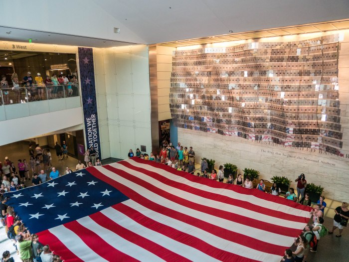 interior shot of national museum of american history in washington dc during the unfurling of the replica flag that inspired national anthem