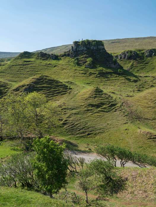 An image of Castle Ewan, a basalt rock formation (and not a ruin) in Fairy Glen, Isle of Skye. It is one of the highlights of the Isle of Skye. #Scotland #FairyGlen