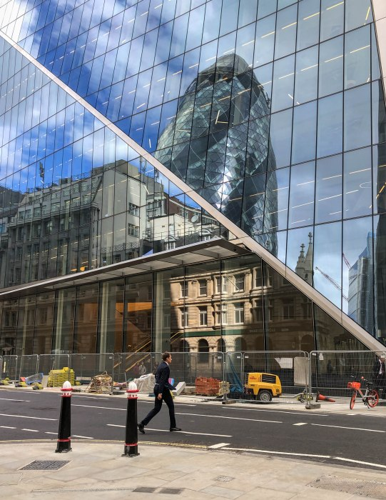 city of london reflections of the gherkin sunny day