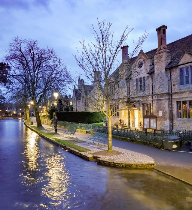 bourton-on-the-water main canal at dusk in winter