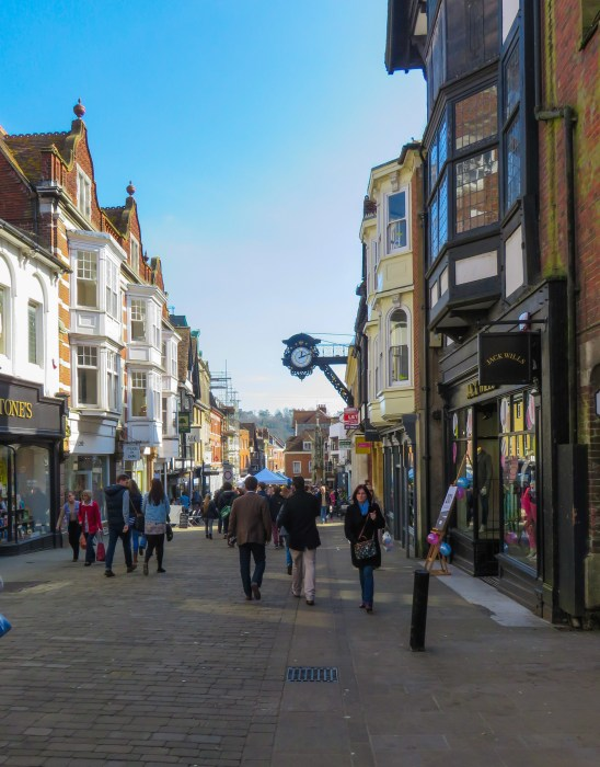 high street winchester england with view of 18th century clock