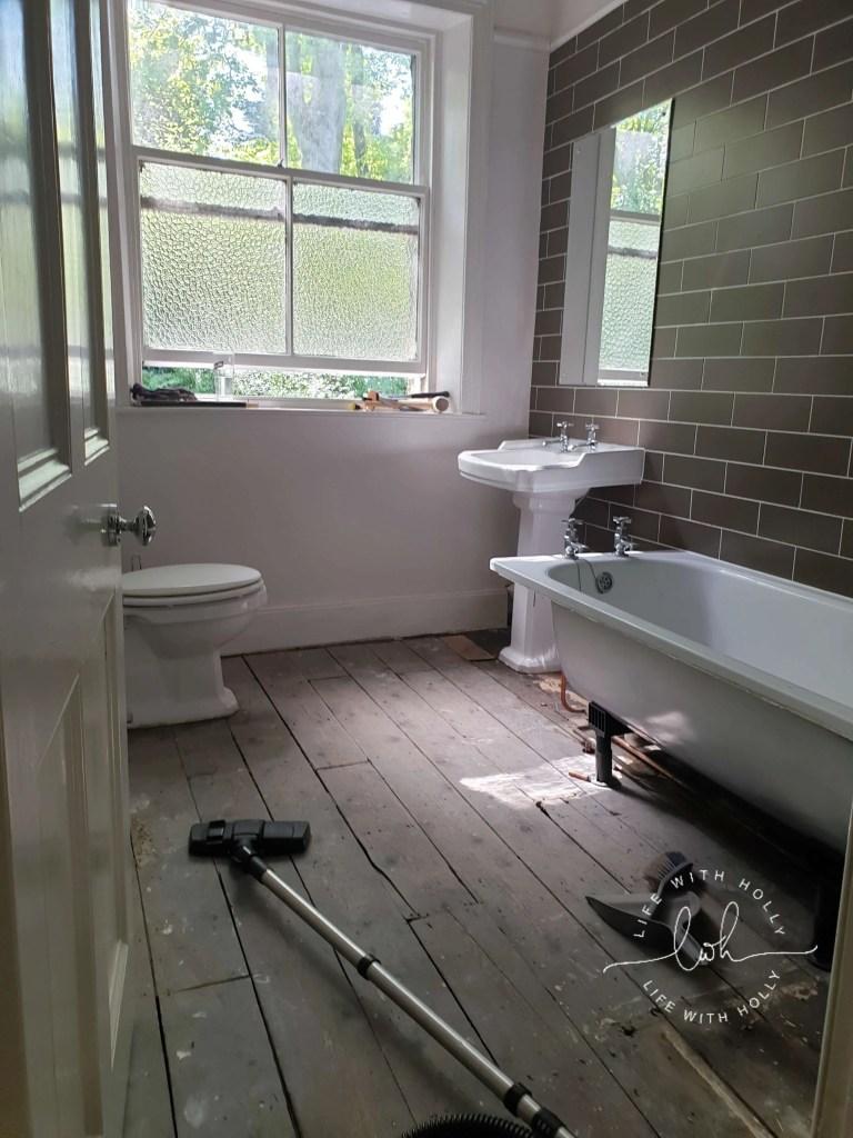 Modern Victorian Bathroom with Dark Wood Wall Panelling by Life with HollyModern Victorian Bathroom with Dark Wood Wall Panelling by Life with Holly