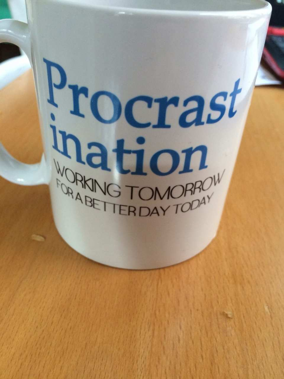 """Productive Monday Mornings start with a Procrastination mug - a white mug with the words """"Procrastination: Working Tomorrow For A Better Day Today"""""""