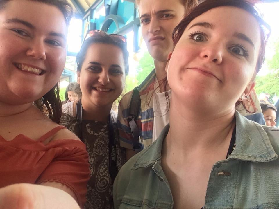 A photo of me, Mary, Jason and Nuala standing in the queue for It's A Small World ride in Disneyland Paris - the people who make me feel confident.
