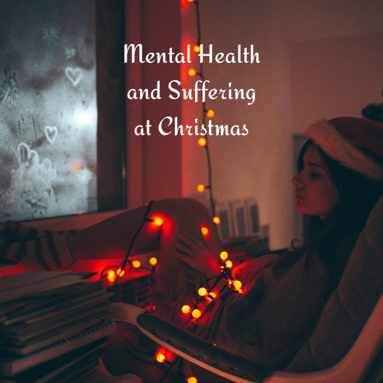 Mental health and suffering at Christmas -  lonely woman in the dark