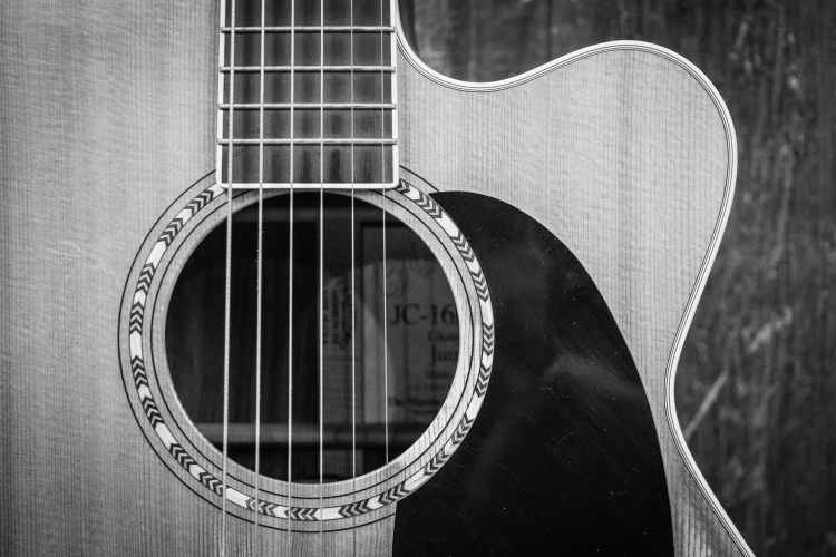 grayscale photo of cutaway acoustic guitar for April 2021