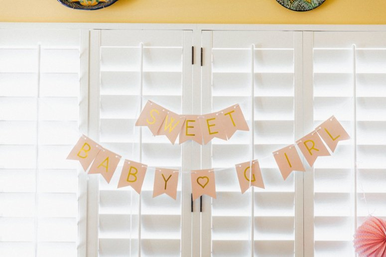 baby girl baby shower banner. Click to see the rest of the details from this tea party baby shower in the post!