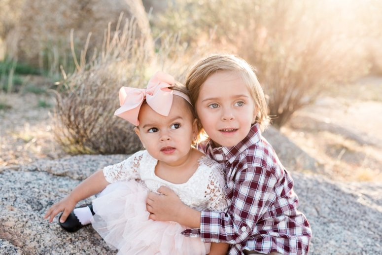 What to wear for family pictures outside | siblings sitting outside for family photos in desert | lifewithmar.com