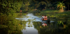 A traditional long boat in the canals near Alleppey, Kerala.
