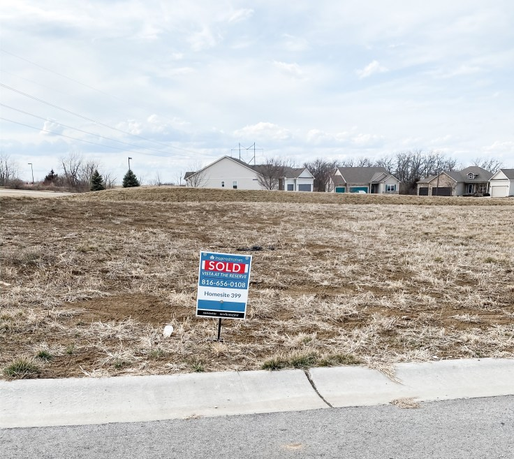 Lot w/ SOLD sign