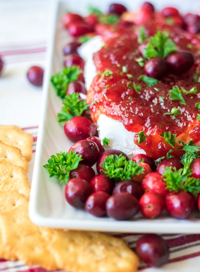 Cranberry Pepper Jelly Dip is just 3 ingredients and everyone's favorite festive appetizer! Comes together in just minutes, perfect for the holidays!