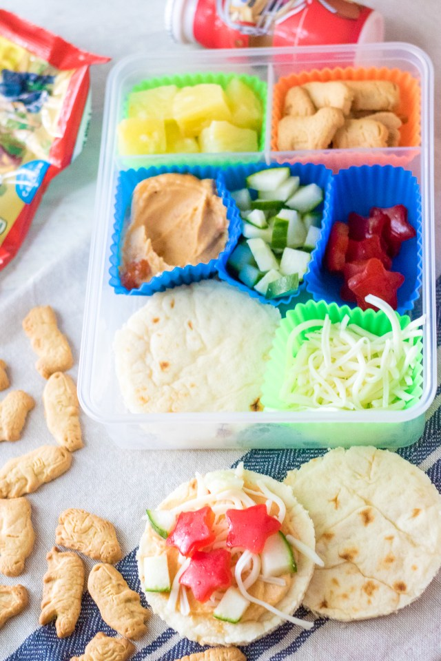 DIY Mediterranean Pizza Lunch Box is a fun and delicious lunch your kids can make themselves! Perfect for back to school and a change from sandwiches!