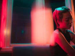 Led lights asian woman sitting girl alone at night