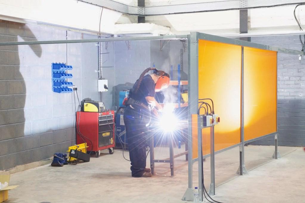 Engineer working on welding bay
