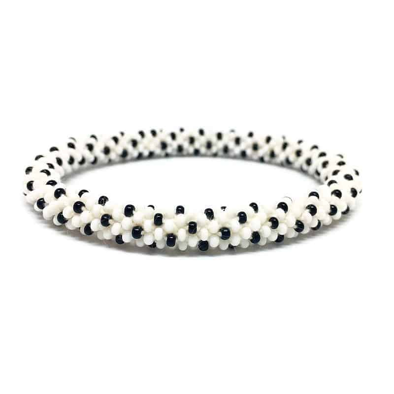 White and Black Dotted Pattern. Beads Nepal roll on