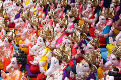 A background of different Ganesh Idols for sale on the occasion of Ganesh festival in India.