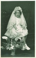 Maire de Paor (née McInerney) in her First Communion dress, May 1948. Her Limerick lace veil was made by Mai Spillane of 12 Wickham Street, Limerick. CREDIT: Maire de Paor/Limerick Museum and Archives
