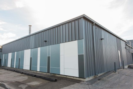 Commercial siding with Hardie panel cement board