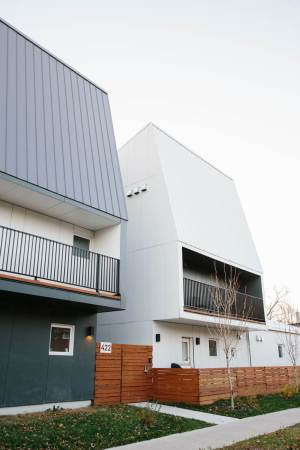 Two units of multifamily building with vertical siding