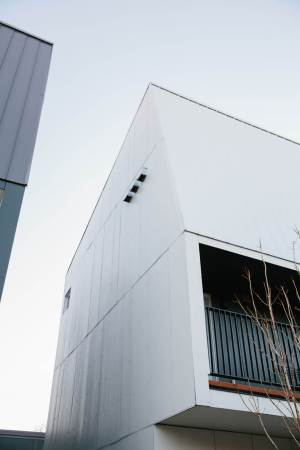 Building with custom installed Hardie cement panels