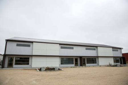 Commercial multi door building with aluminum siding and Hardie panel exterior