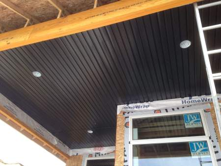 Custom aluminum soffit with pot lighting