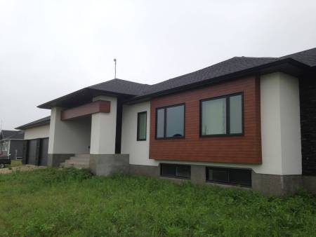 New Winnipeg custom home with cement board siding