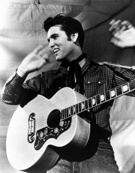 "Elvis Presley is shown with his Gibson J-200 guitar in a 1957 MGM studio publicity photo. Born in Tupelo, Miss., Elvis was an immediate sensation in the mid-1950s with his blend of blues rock and rockabilly. Because of his stage gyrations, television producers initially refused to show him below the waist on screen. Critics called him ""Elvis the Pelvis,"" but his fans called him the ""King of Rock 'n' Roll."" The Elvis empire grew with live performances, records, films and a grand estate in Memphis,Tenn., known worldwide as Graceland. Elvis died at Graceland on Aug. 16, 1977. He was 42. (AP Photo)"