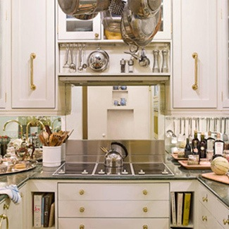 http://www.apartmenttherapy.com/mirrored-backsplash-110264
