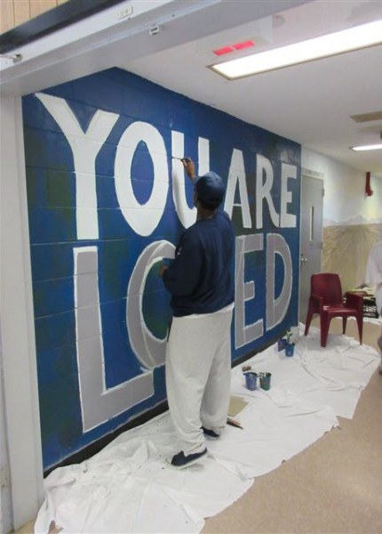 Inmate working on a YOU ARE LOVED at Bridgewater State Hospital