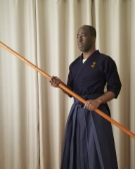 This is a rokushaku bō (6-shaku staff). It is the appropriate size and weight for studying bōjutsu.