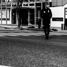 Man walking on pedestrian crossing