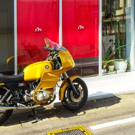 Yellow bike in front of red window