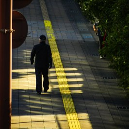 Man with yellow line