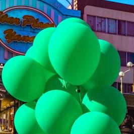 Retro street with green balloons