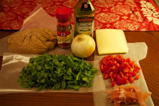 Ingredients for making Arugula and Prosciutto Pizza