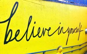 'believe in yourself' graffiti on yellow wall