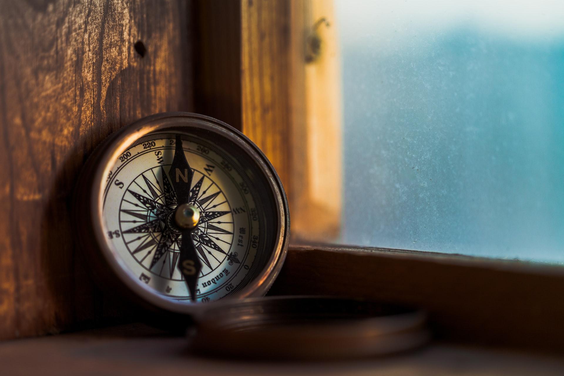 open compass in windowsill