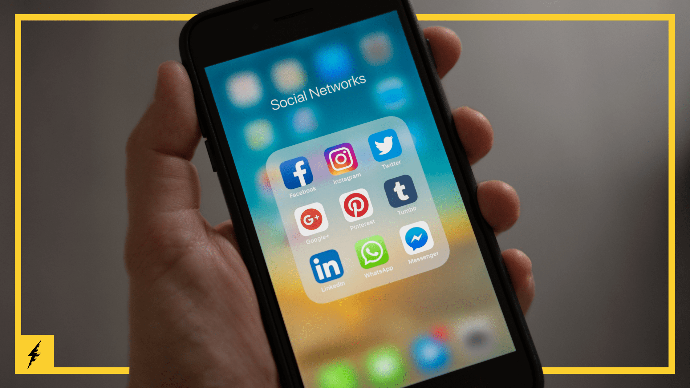 A mobile phone displays app icons for various social media networks.
