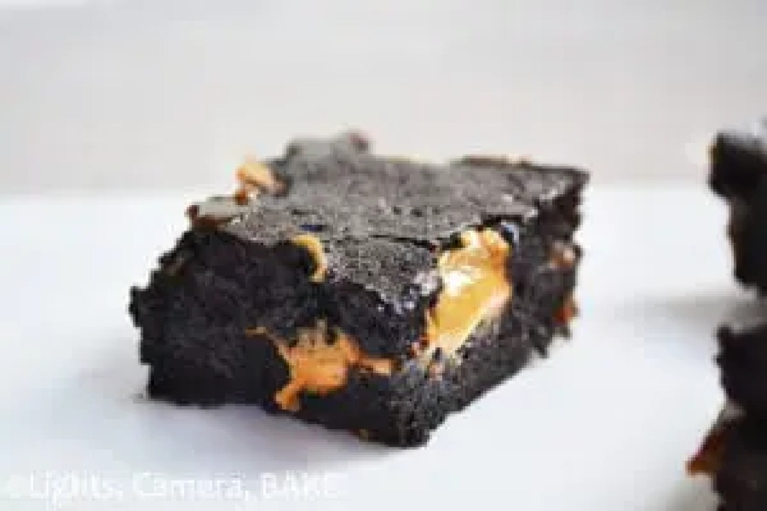 Peanut Caramel Fudge Brownies. Rich and fudgy cocoa brownies with pockets of peanut butter and swirled with homemade caramel. These are seriously rich and decedent. Click the photo for the #recipe . #peanutbutterbrownies #caramelbrownies #cocoabrownies