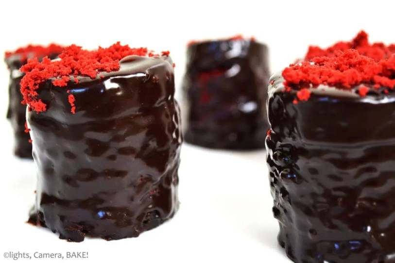Red Velvet Brownie Stack. A decadent yet simple red velvet cake and brownie stack covered in chocolate ganache. Perfect for Mother's Day or Valentines Day. #redvelvetcake #brownies #redvelvetbornwies #chocolateganache