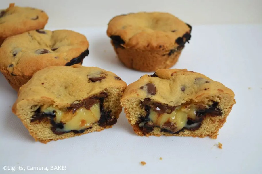 Caramel Hot Fudge Cookie Cups are a chocolate chip cookie baked in a muffin tray and filled with a buttery caramel sauce and homemade hot fudge chocolate sauce. This is one over the top treat your family will go crazy for! #hotfudgecookiecups #cararmelcookiecups #cookiecups #caramelhotfudgecookiecups